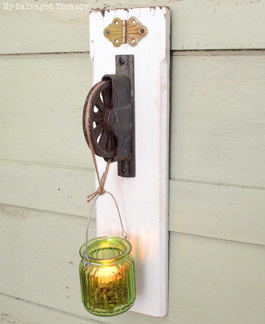 repurpose a rusty pulley and scrap lumber into an LED tea light holder