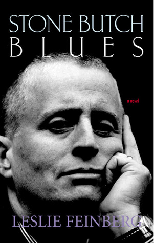 "A cover of ""Stone Butch Blues"" by Leslie Feinberg, featuring a black and white portrait of Feinberg with hir left hand on the side of hir face, looking thoughtful."