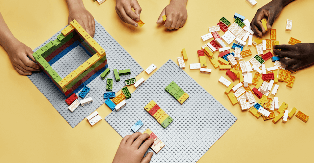 Children using LEGO Braille Bricks to read and to build with.