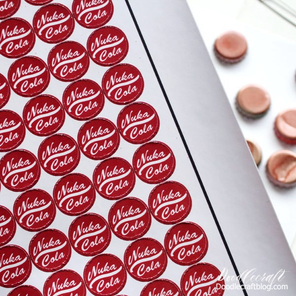 Step 3 for Nuka Cola Caps: Now that the stickers are cut and the caps are painted, simply place a sticker on the top of each cap.