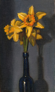 Oil painting of three yellow daffodils in a blue castor oil bottle.