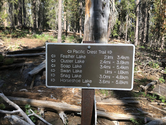 trail marker sign to lots of lakes