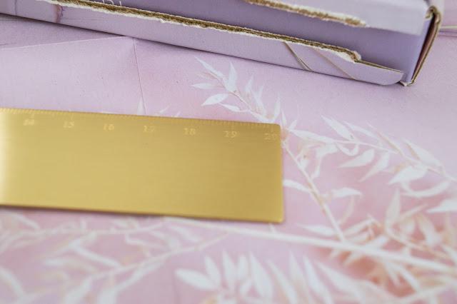 Closeup of a gold ruler
