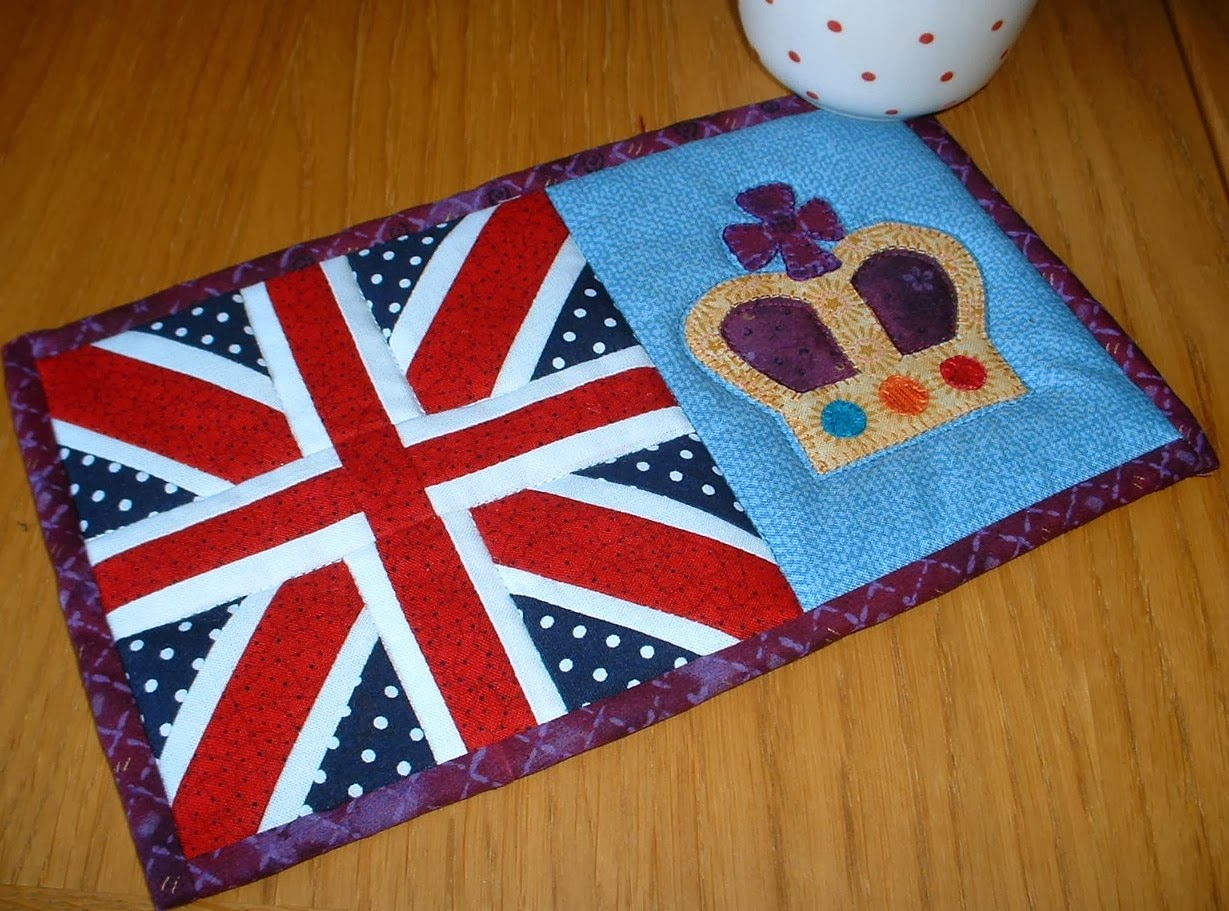 http://www.craftsy.com/pattern/quilting/home-decor/union-jack-mug-rug/51744