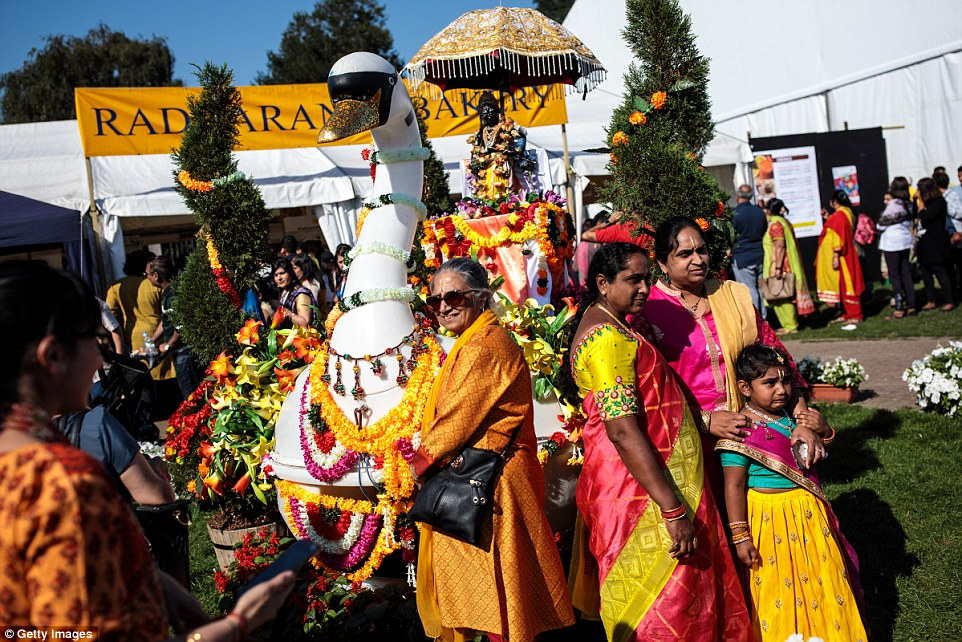 Women dressed in bright colours as they enjoyed festivities in Watford over the weekend for the annual Janmashtani event