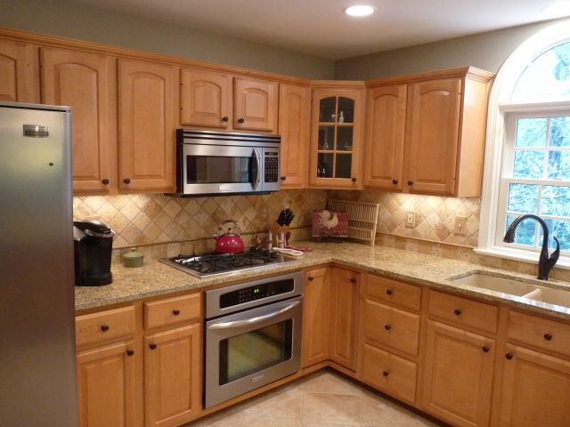 The Granite Gurus: Reader's Kitchen with Ouro Brazil Granite on What Color Countertops Go With Maple Cabinets  id=68818