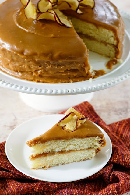 homemade southern caramel cake with caramel icing and apple chips one slice served