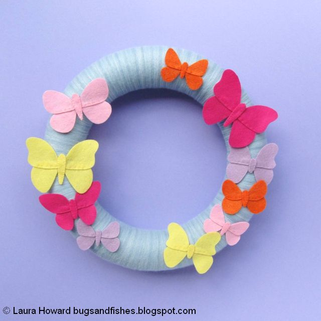 yarn-wrapped wreath decorated with felt butterflies