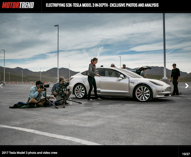 Screenshot from Motor Trend of Tesla model 3 with people around it