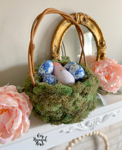green moss grapevine basket Easter eggs mirror