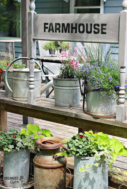 Foot-board Farmhouse Sign on the Deck #upcycle #stencil #oldsignstencils #decoart #farmhouse #junkgarden #gardenjunk #containergarden
