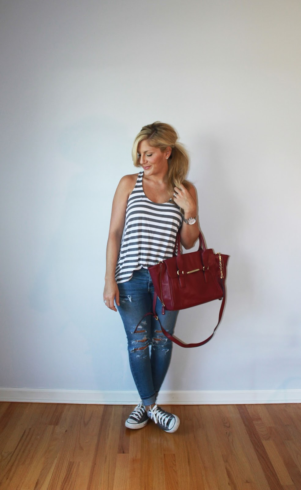 af776f6de18b1 What I'm wearing...striped tank top: Old Navy (similar), distressed denim:  Target (similar), sneakers: Converse, burgundy bag: Target (similar), ...