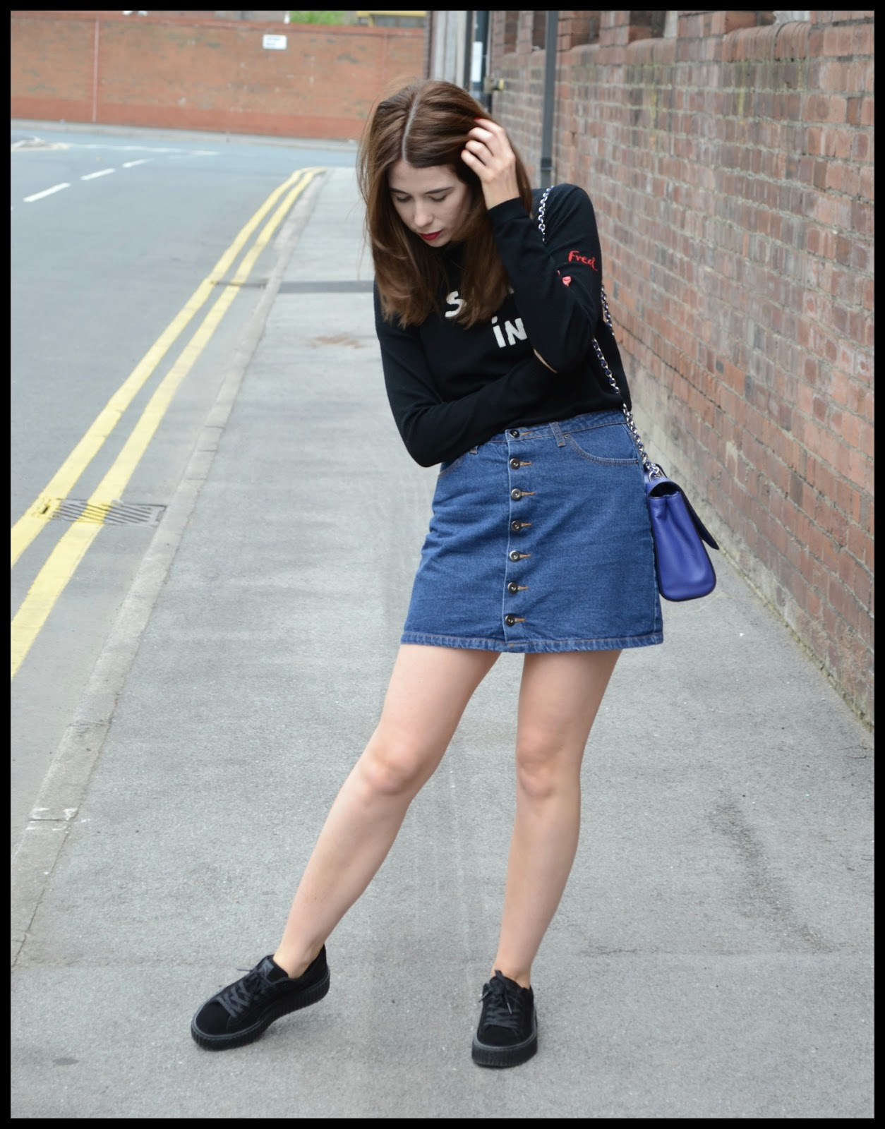 Bella Freud sporting Cashmere jumper, Denim button down skirt, Black creeper puma fenty trainers, Blue medium Lily Mulberry bag
