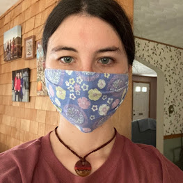 fair trade jewelry with mask