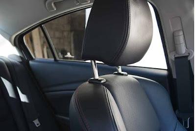 como colocar bien el reposacabezas del coche
