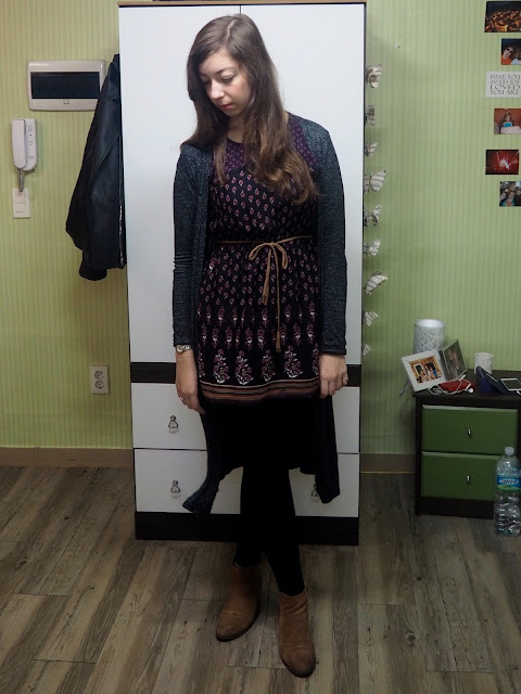 Purple Plum Patterns | outfit of short black dress with purple pattern and brown belt, worn with long grey cardigan, black leggings and brown ankle boots