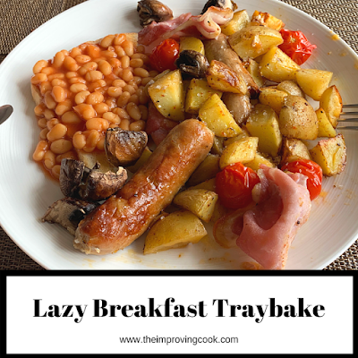 Breakfast traybake on a white plate with beans on toast