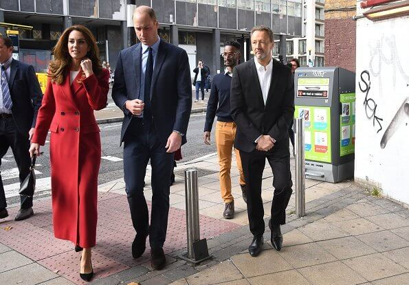 Kate Middleton was chic in a gorgeous autumnal red coat by Alexander McQueen. Grace Han Love bag. Daniella Draper luxury Maxi cupid hoops
