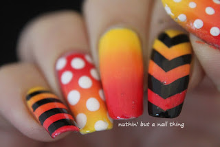 Bold stripe and polka dot nail art
