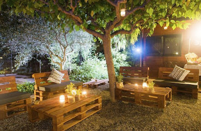 Wedding is celebrated outdoors with Wooden Pallets