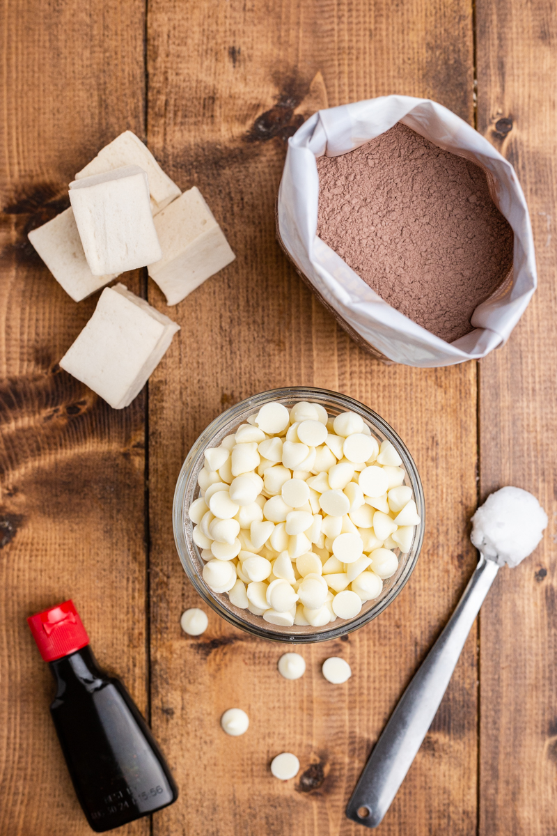 Overhead photo of the ingredients needed to make Keto Valentine Hot Chocolate Bombs on a wooden table.
