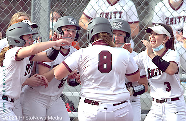 Hailey Flesch receives welcome at home plate after hitting a home run
