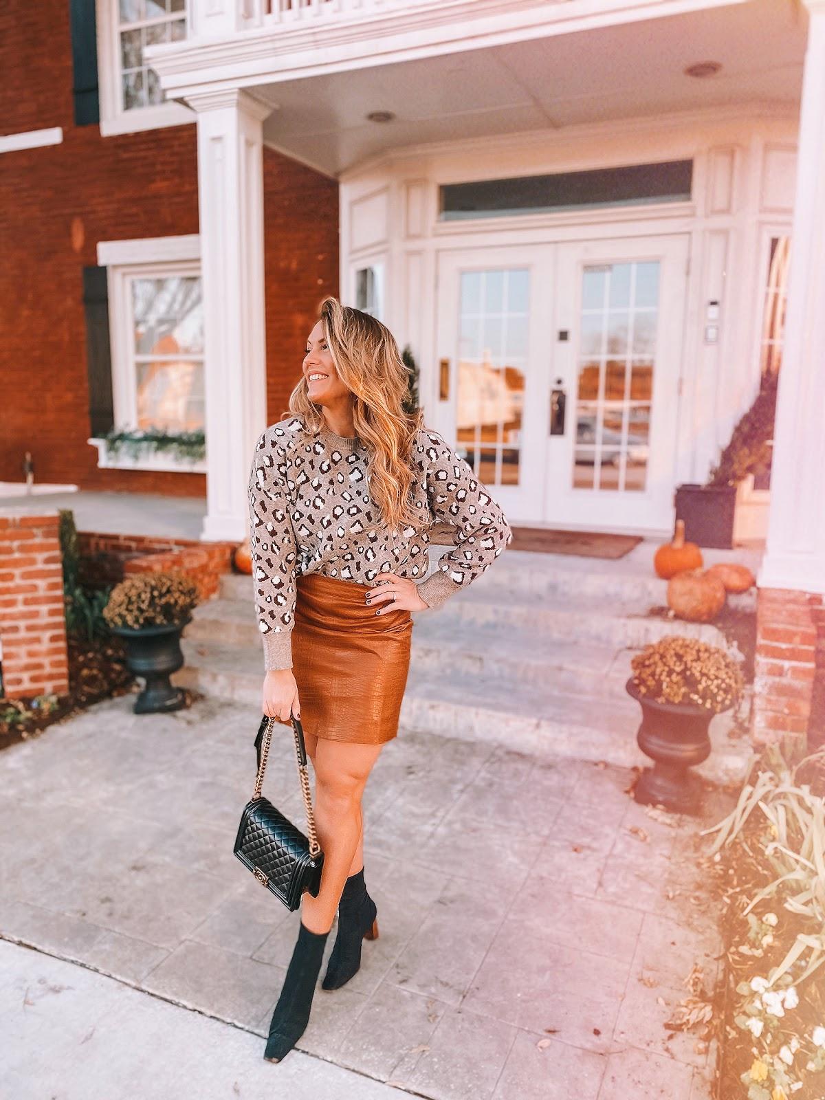 Oklahoma City blogger Amanda's OK wears a grey leopard sweater and a tan leather mini skirt