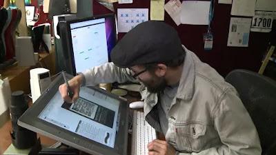 disney animator working in studio on graphics tablet