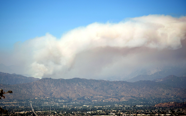 The giant smoke cloud caused by the Bobcat Fire hangs over the San Gabriel Mountains...as seen from the city of Walnut in California on September 19, 2020.