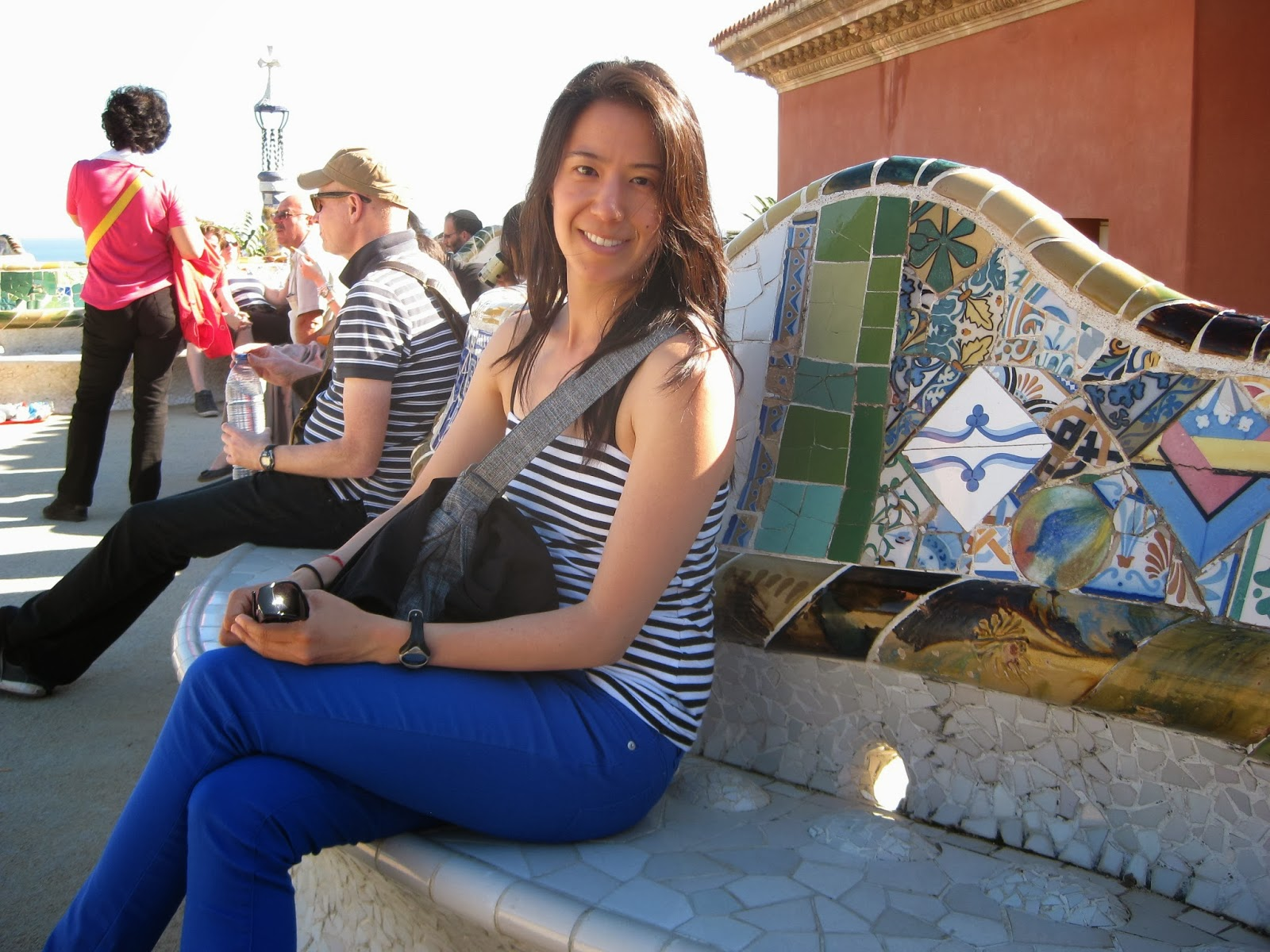 Barcelona - taking a rest on the colorful serpentine bench in Park Guell