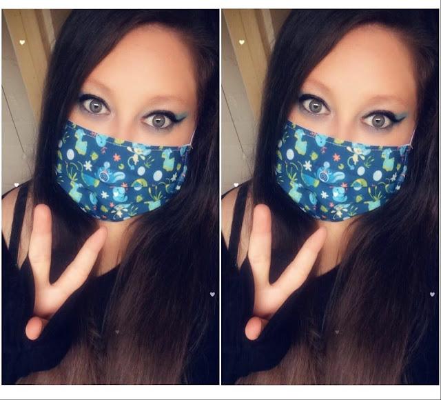 a photo of myself wearing a water type pokemon mask