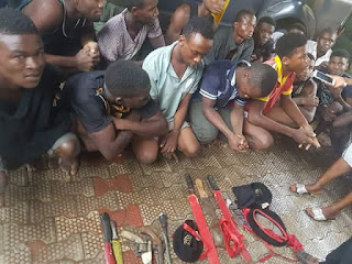 Photos: Police parades suspected armed robbers, cultists, kidnappers in Anambra State; recovers IPOB headgear, flag, charms, ammunition
