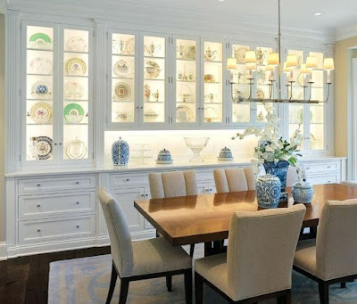 White dining room hutch with lighting
