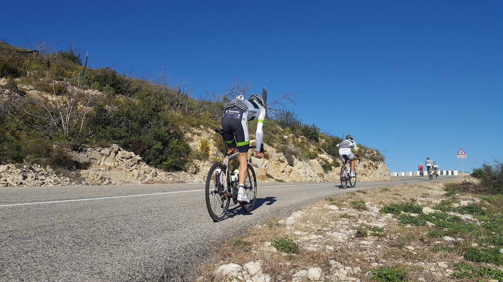 Cyclists climbing Vall d'ebo, Alicante, Spain
