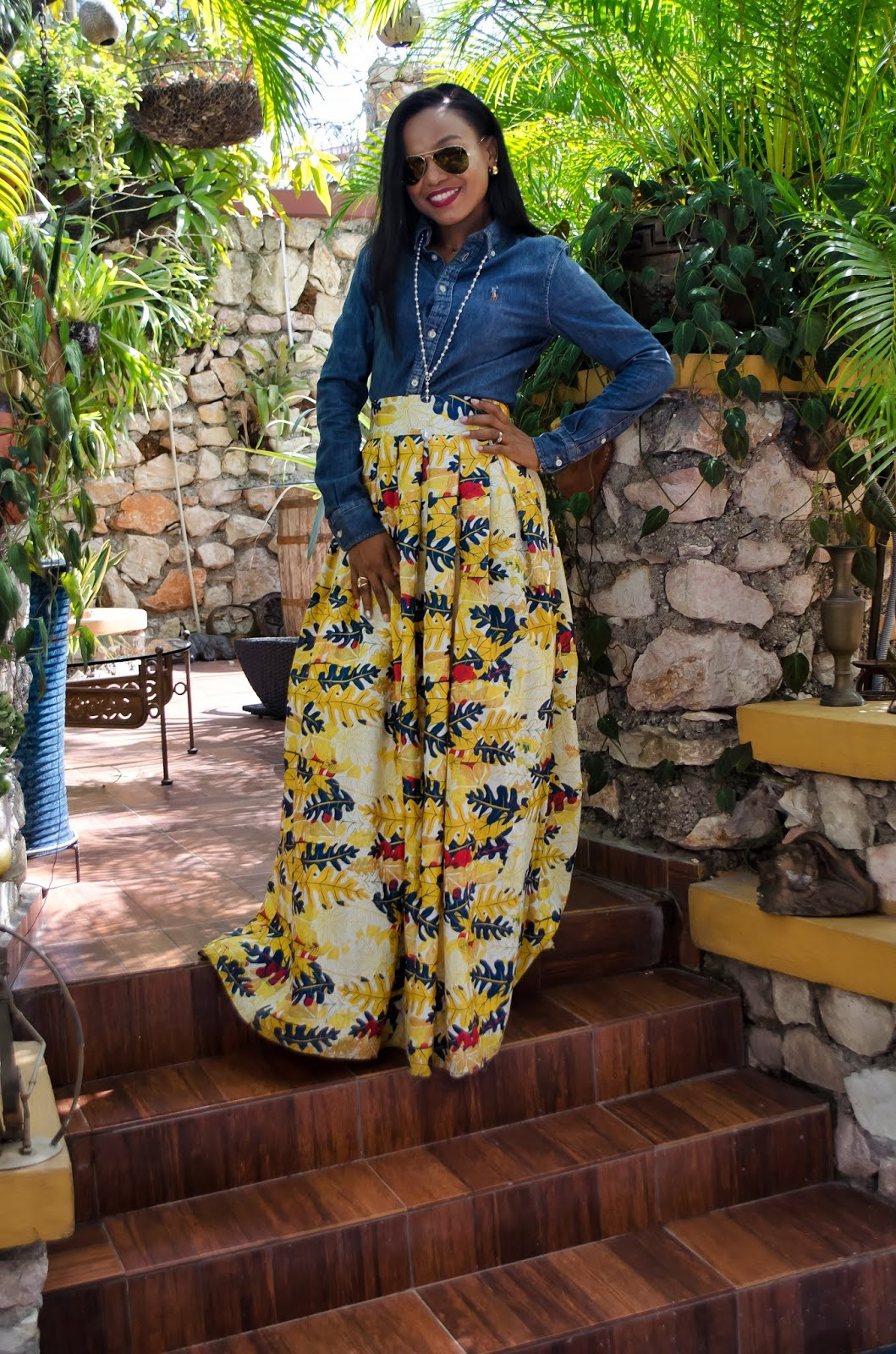 Fashion blogger Iris from La MouMous in denim shirt and long floral skirt