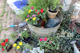 tips for planting flowers in upcyled containers