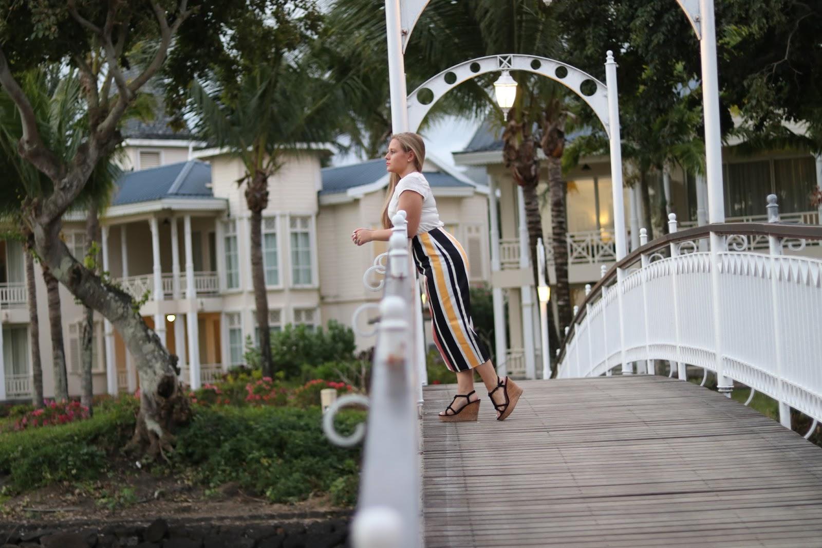 Katie Heath wearing an ASOS skirt at the Heritage Le Telfair Hotel, Mauritius