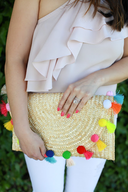 The only clutch you need this summer - pom pom clutch