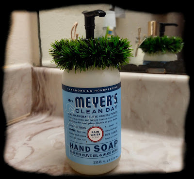 mrs meyer's hand soap with little wreath on top for christmas