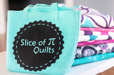 Stack of quilts by Laura of Slice of Pi Quilts