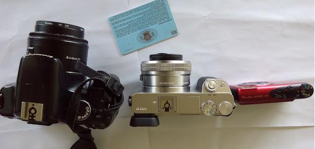 Perbandingan ukuran Sony A6000, Canon EOS 450D, Canon Ixus PowerShot A2200 dan SIM A tampak atas
