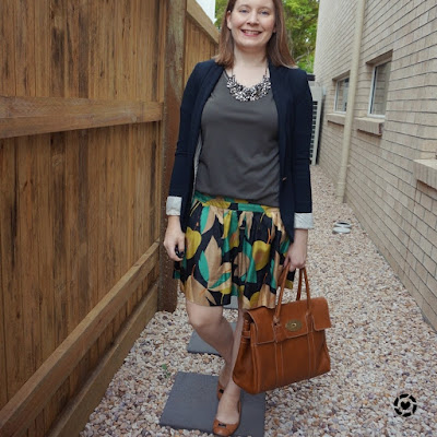 awayfromblue Instagram | olive tee statement necklace jersey blazer silk skirt in office with mulberry bayswater tote
