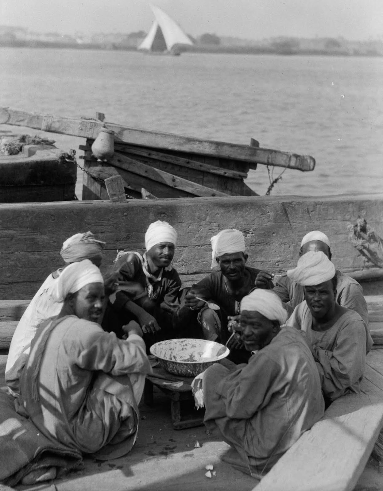 Boatmen eat lunch on the banks of the Nile. 1934.