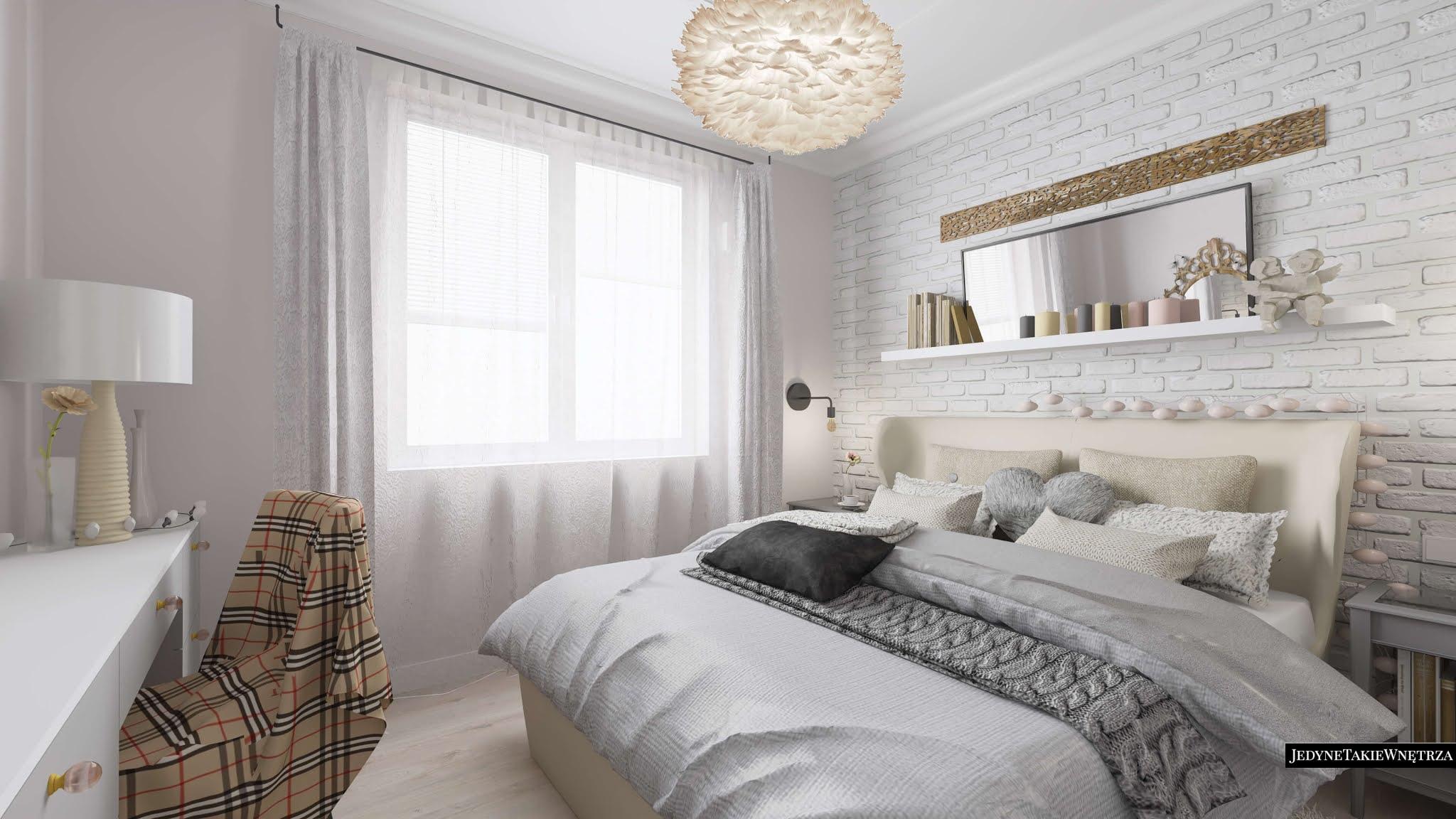 Romantyczna sypialnia, której ścianę zdobi tapeta z motywem białej cegły. Duże podwójne łóżko z wezgłowiem, nad nim wisi biała półka z książkami oraz poziome lustro.