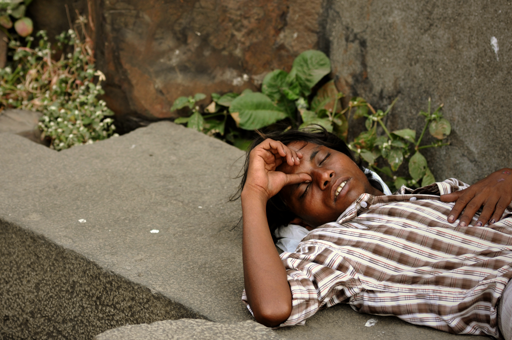 Portrait photo of a boy sleeping in India.