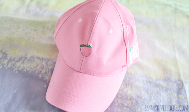 Details on the pastel pink embroidered peach baseball cap from Gamiss.