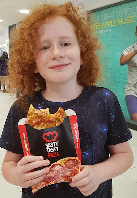 My 10 year old eating Hasty Tasty Pizza from Blackburn Mall