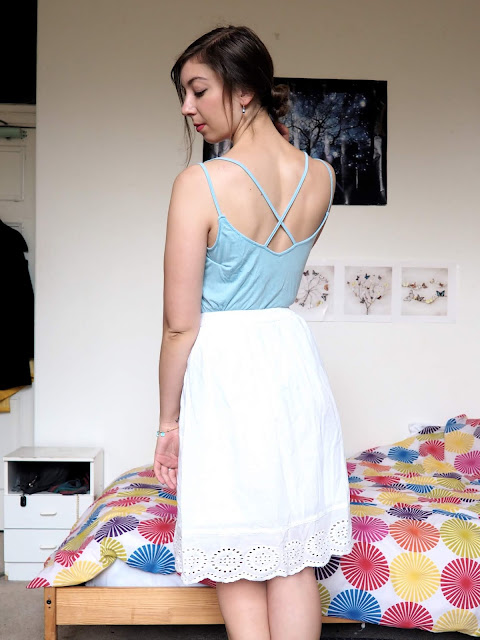 Cinderella Disneybound outfit of strappy pale blue top & floaty white skirt