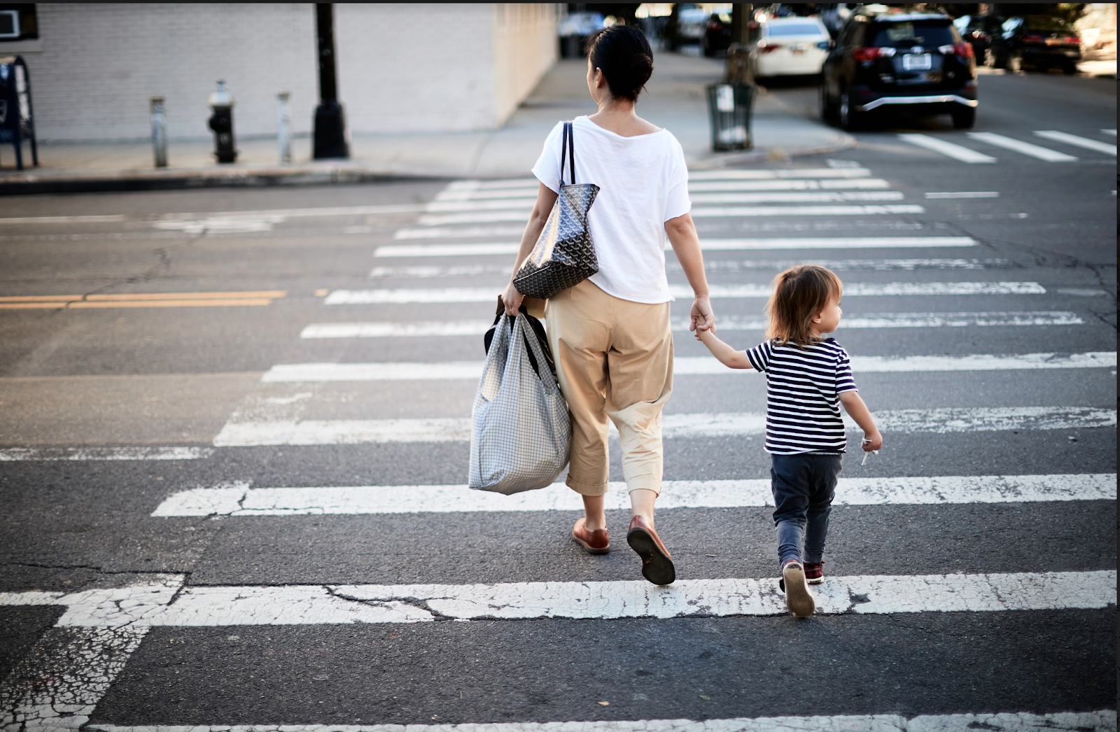 woman and child crossing the street