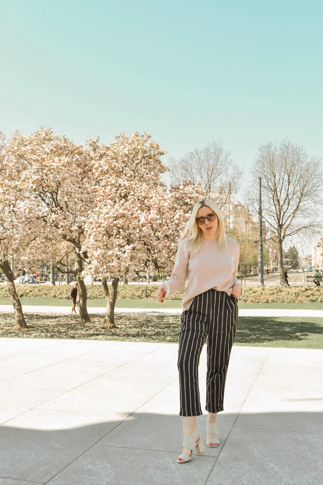Pink sweater and striped pants outfit